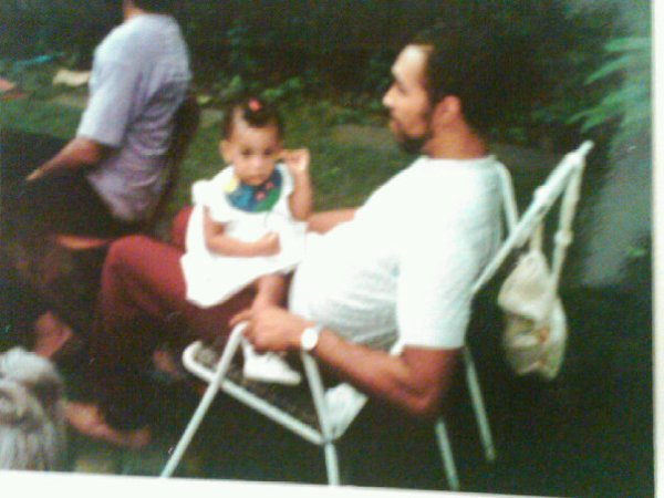 My father and I at a bbq when I was a year old.