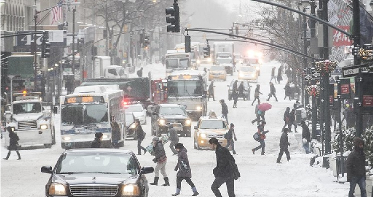 Pedestrians on 5th avenue in NYC this morning